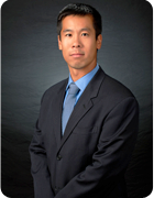 Photograph of law firm member Mr. Brian Ku
