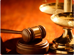 Photograph of scales of justice and gavel